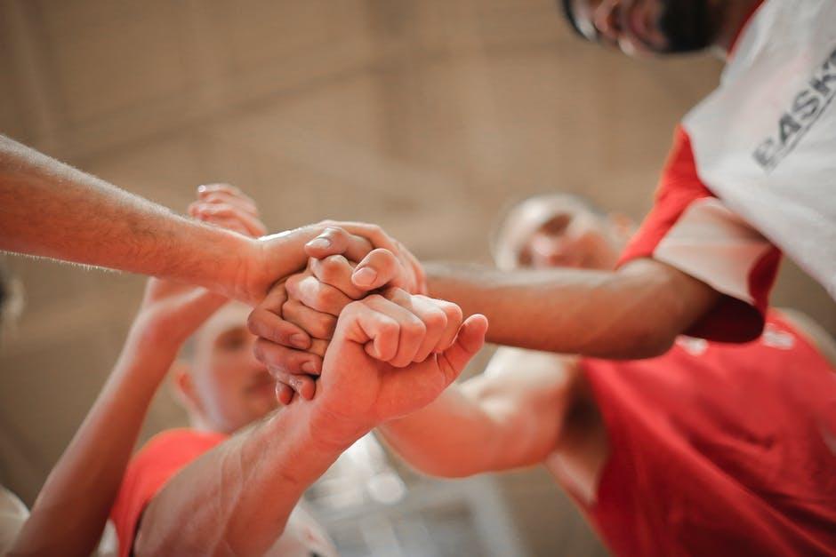 teamwork fist huddle